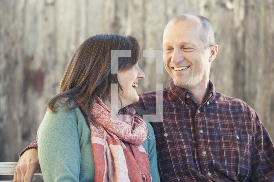 commitment. Joyful couple smiling and looking at one another.