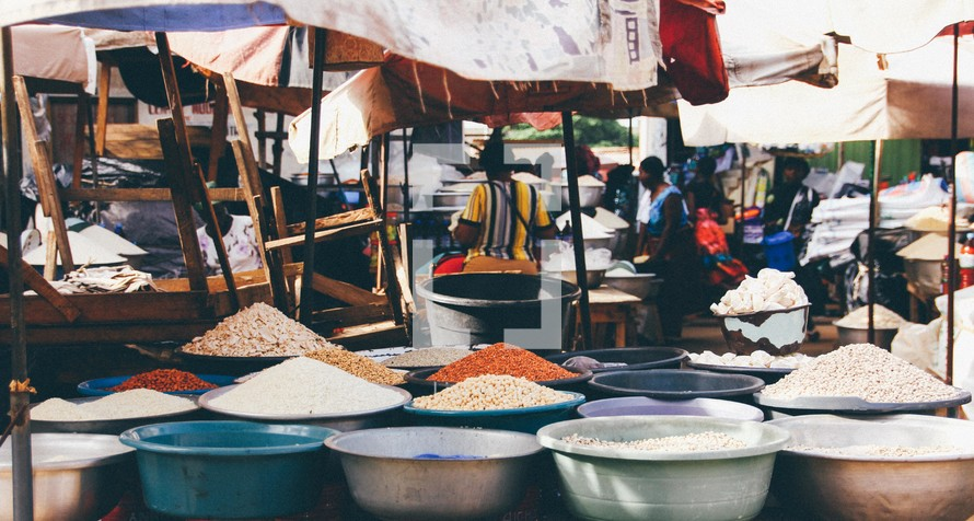 grains and spices in an outdoor market