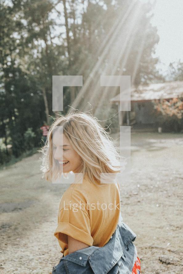 sunbeam shining on a young woman