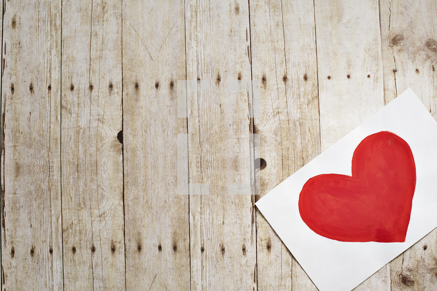 painting of a red heart on paper