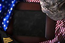 blank chalkboard with American flag and military uniform border