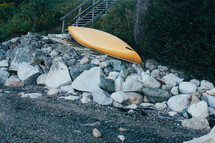 overturned canoe on a rocky shore