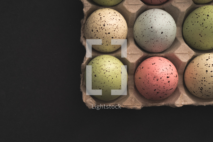 speckled dyed Easter Eggs in a carton