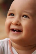 a face of an Asian toddler