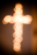 Blurred out lights form the cross