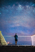 a man looking up at the stars