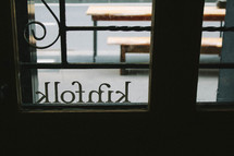 kinfolk sign in a window