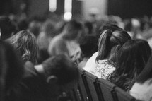 parishioners with heads bowed in church