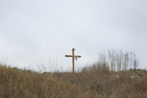 a cross on a hill top