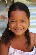 Smiling face of a young polynesian girl