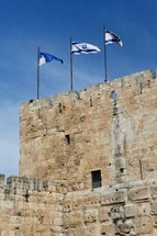 Israeli flags on the old city wall in Jerusalem
