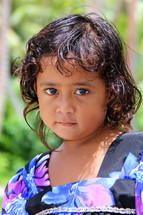 Face of a young Micronesian girl dressed to go to church