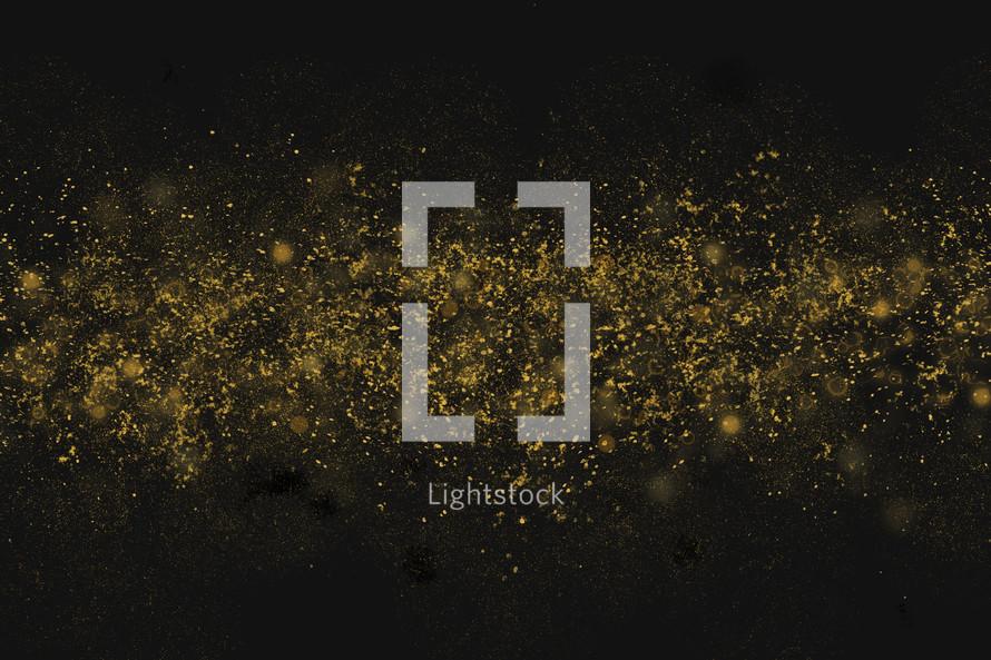 gold sparkle on a black background