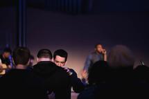 greetings and prayer at a worship service