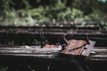 old train tracks and rusty nail spikes
