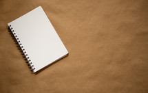Blank spiral notebook with copy space on rignt ready for customized text or images.