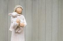 Shepherd and a lamb figurine