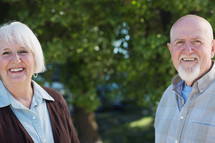 portrait of a mature couple standing together outside.