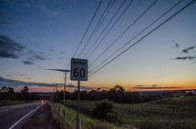 highway, speed limit sign, and powerless at sunset