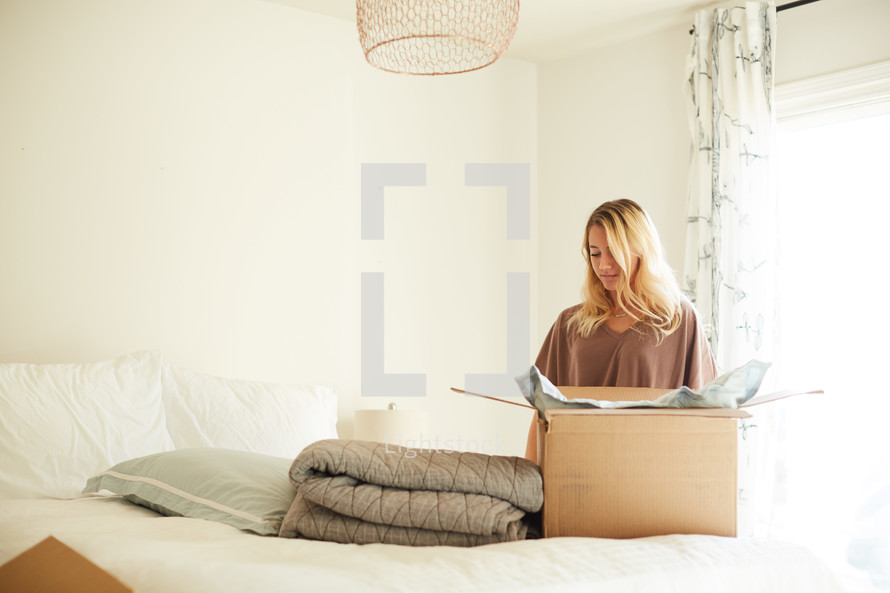 a woman packing a moving box