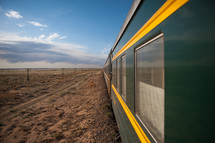 Train traveling through a desert land.