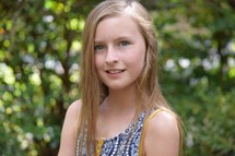 headshot of a caucasian preteen girl