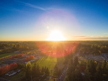 sunburst over a small town community