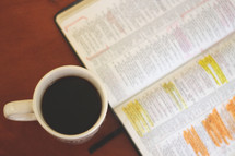 coffee mug and highlighted open Bible