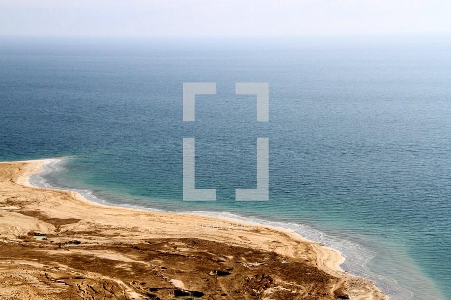 A sea with a barren shore.   The Dead Sea