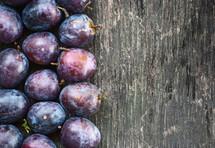 plums on wood