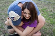 teen boyfriend and girlfriends hugging