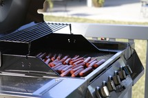 hotdogs on a grill