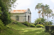an old church and palm trees
