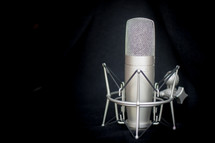 A radio broadcasting studio microphone with shock-absorber stand.