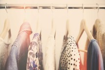 clothes on hangers in a closet