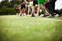 athletes in the runners stance at the starting line