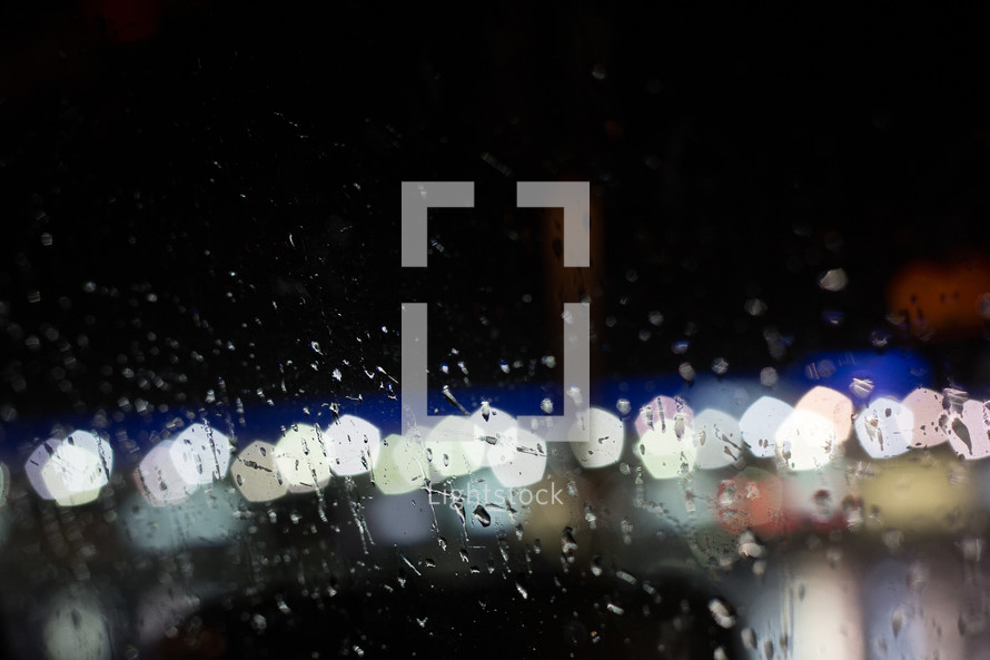 water droplets on glass and bokeh lights