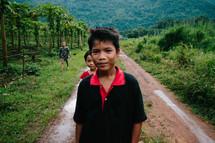 barefoot children on a dirt road