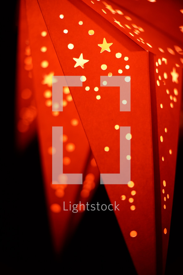 A shining red paper star lantern.