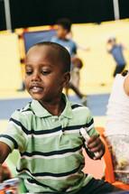 a boy child holding a marker