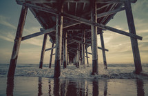 Tide washing onto a beach under a pier | Sunset | Coast | California | Land | Sea | Sky | Background | Landscape | Nature | Depth | Perspective