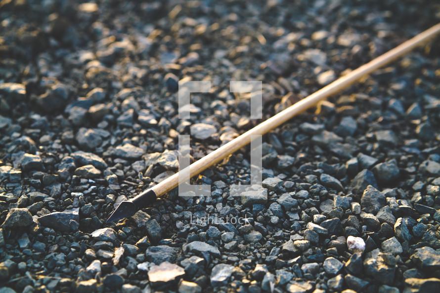 arrow on gravel ground