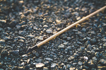 arrow on gravel ground