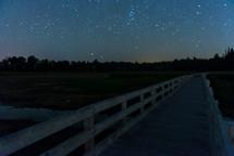 stars over a wooden boardwalk