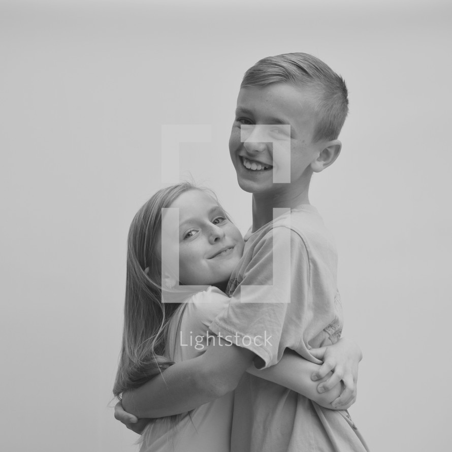 A brother and sister hugging