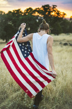 a man holding an American flag behind his back