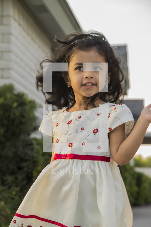 a toddler girl in a floral formal dress