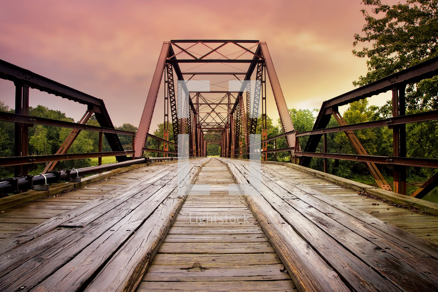 old rusty steel and wooden bridge