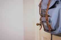 book bag hanging on a door