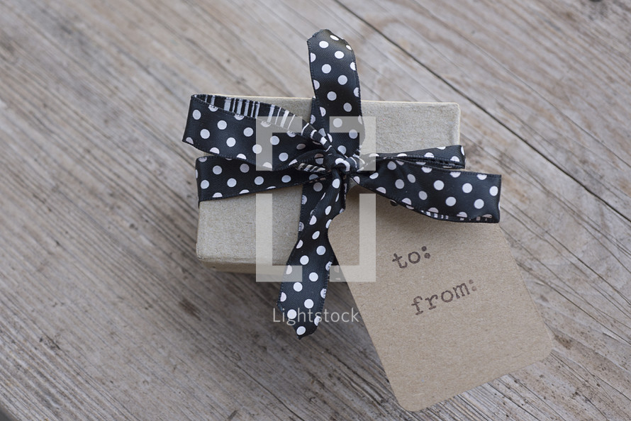 gift with a gift tag, to: and from: